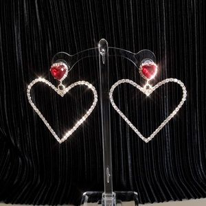 Jeweled ruby oversized heart shape earrings